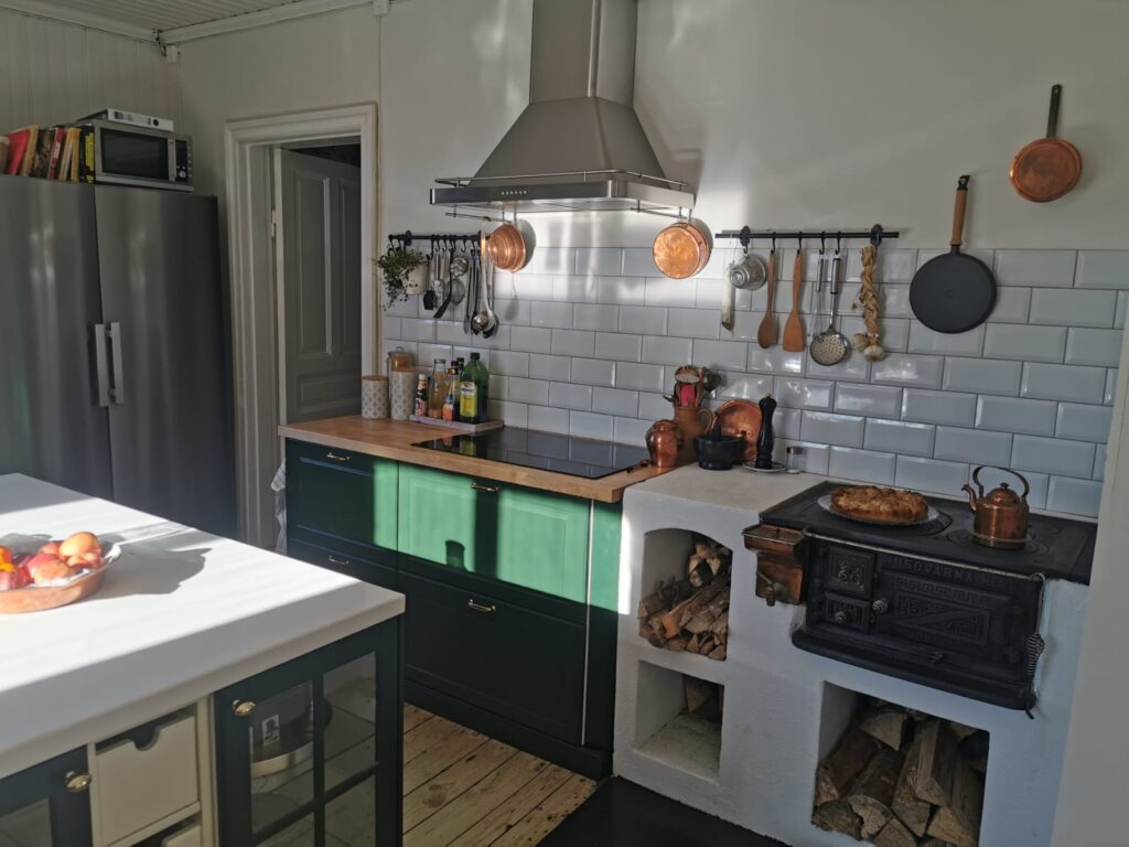 Metro tiles and green cabinets